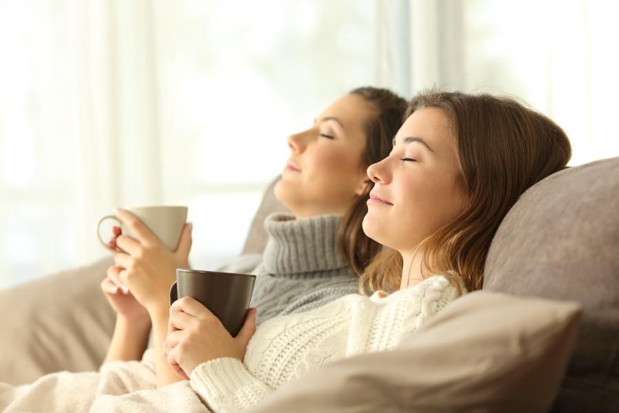 Ladies sat holding mugs