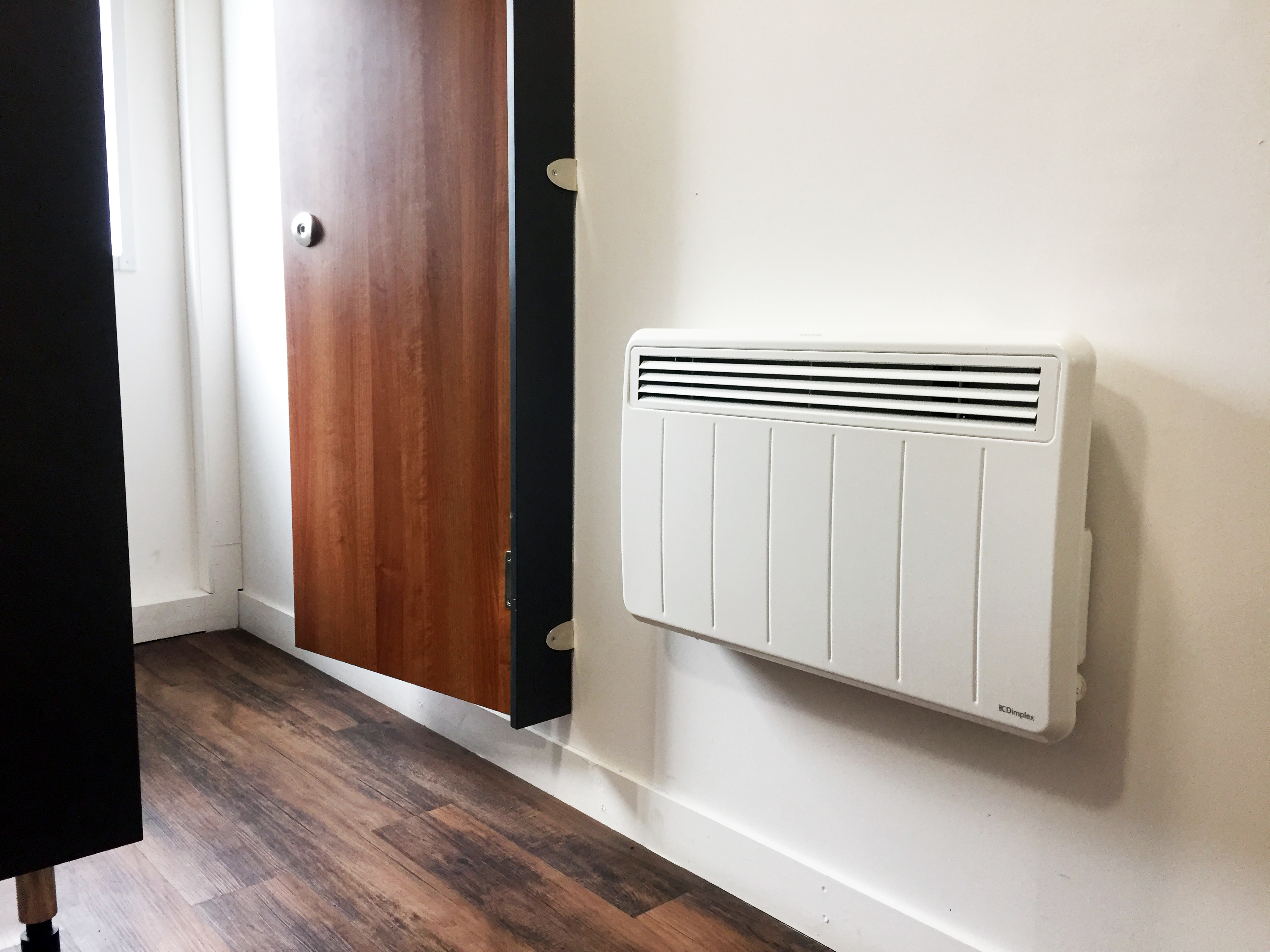 Dimplex PLXE electric panel heater in the Veterans' Garage toilets