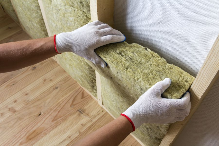 Home insulation being installed in walls