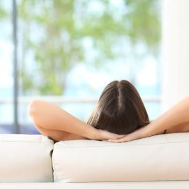 Lady relaxing on sofa