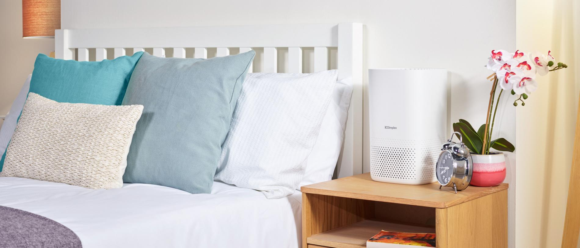 bright bedroom with air purifier on drawers