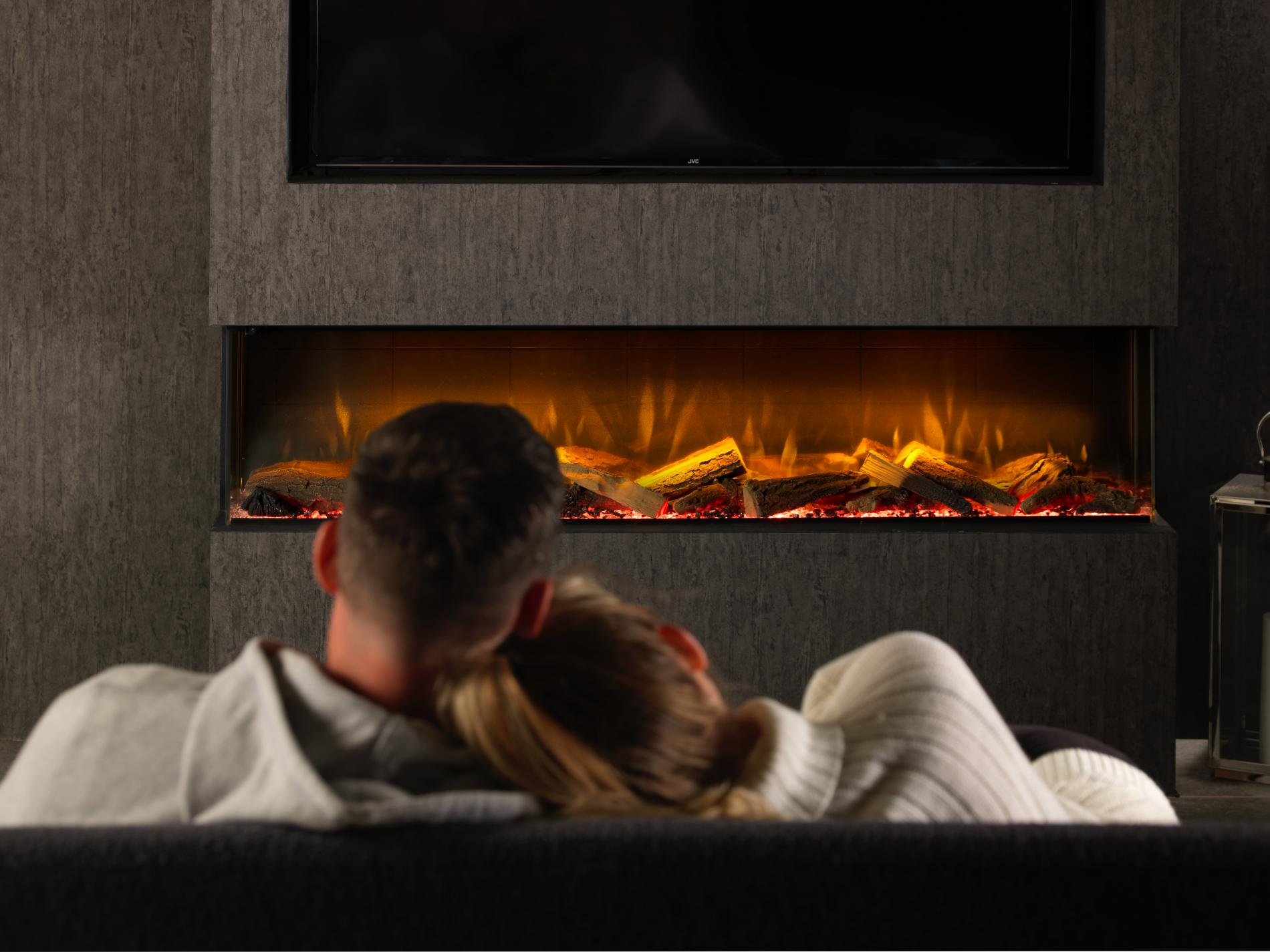 fireplace couple sitting next to eachother