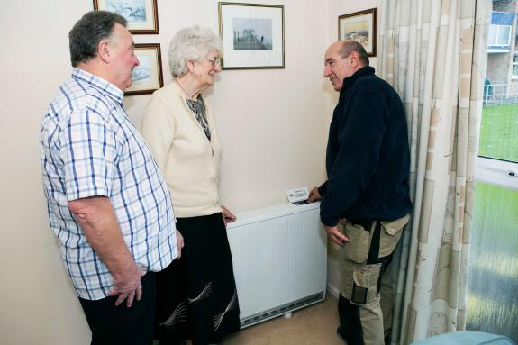 The Preston's are shown their new Quantum heater at Carolyn House