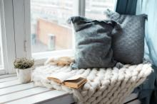Book and cushions on a window seat