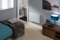 Bedroom electric panel heater with radiant panel