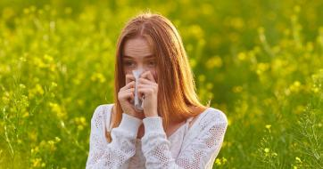girl in fields with hay fever